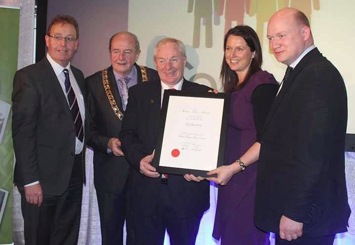Brian Tyrrell, Martin Brett, Nora Darcy and David Fitzgerald from Kilkenny receive the best large town award from Minister Michael Ring at the Fáilte Ireland tourism towns awards in the Gibson Hotel November 28 2013. (Bord Failte)