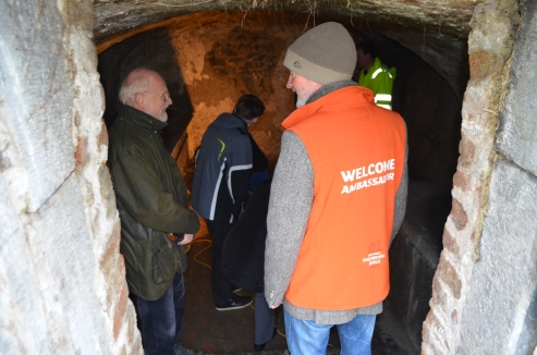 One of our City Welcome  Ambassadors  assisting with access to a historic crypt.