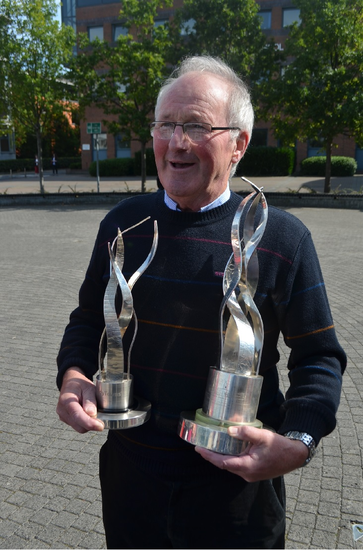 Sean Leahy holds the National Tidy Towns award Trophy 2014 and the  Overall Large Urban centre award 2014