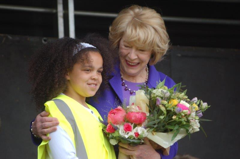 Presentation to Sabina Higgins of flowers by Ebony Masuku