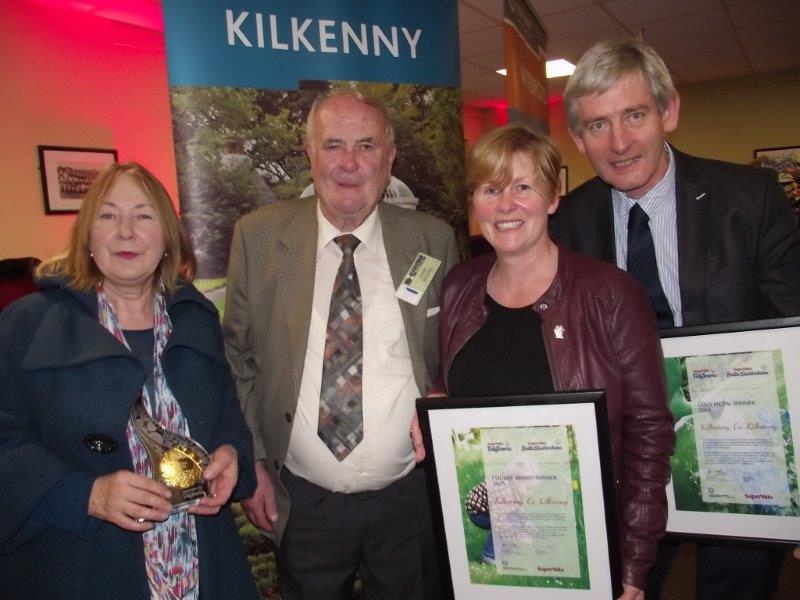 Members of the keep Kilkenny beautiful celebrate with Clonegal Tidy Village Association chairman following the award ceremony.