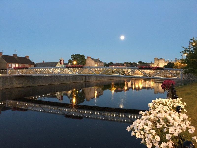 Lady Desart bridge reflected in the still evening.